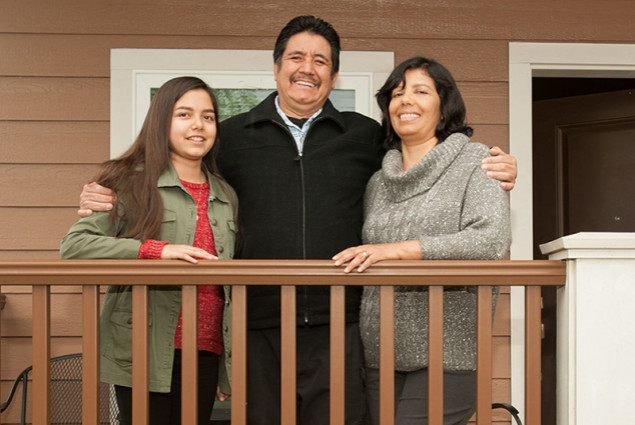 Mauricio and Maria Huerta with 12-year-old daughter, Jenny.