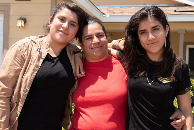 Homeowner Sandra Gonzalez with her daughters Abigail, 13, and Aurora, 17.