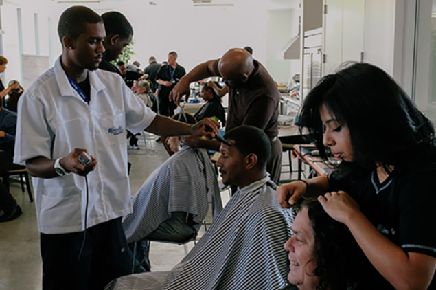 Students from a local beauty college spend a day giving residents haircuts and styling, manicures and pedicures.