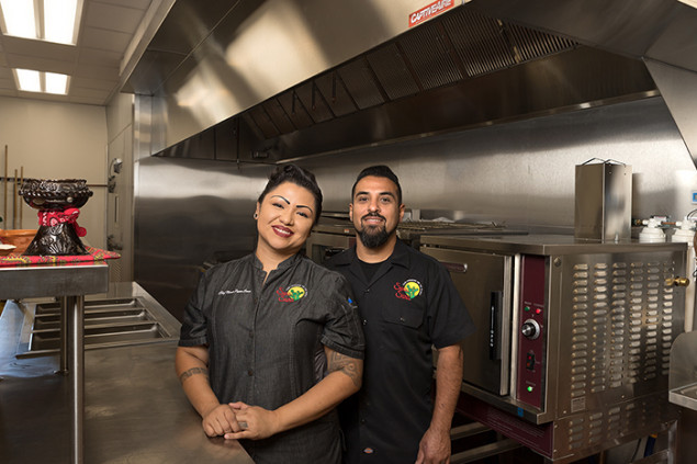 Chef Maria Parra Cano and husband Brian Cano in the kitchen at the Phoenix Indian School Visitor Center.