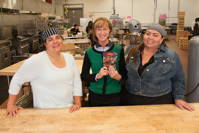 Kelly Smith, Director of Marketing and Social Media at Santa Cruz Community Credit Union, visits the kitchen, pictured with Carmen Herrera-Mansir and Amy Mascareñas